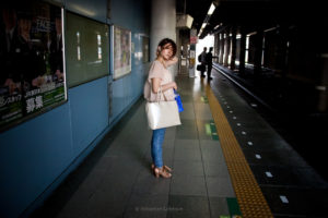 Japan - Tokyo - Portrait of woman waiting for the train.