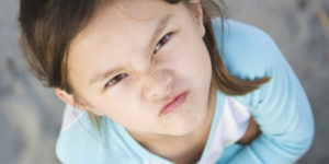 Angry Asian girl frowning