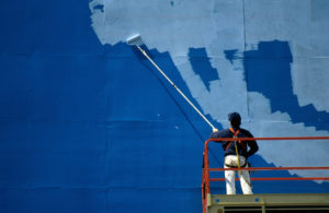Man painting billboard
